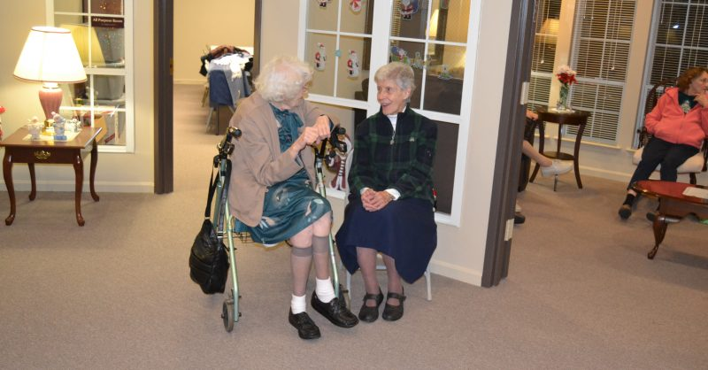 Ladies of Charity Member Sister Sheila O'Friel, DC, (right) chats with Thelma Deatherage, a resident of the senior housing facility in Emmitsburg, MD (left).